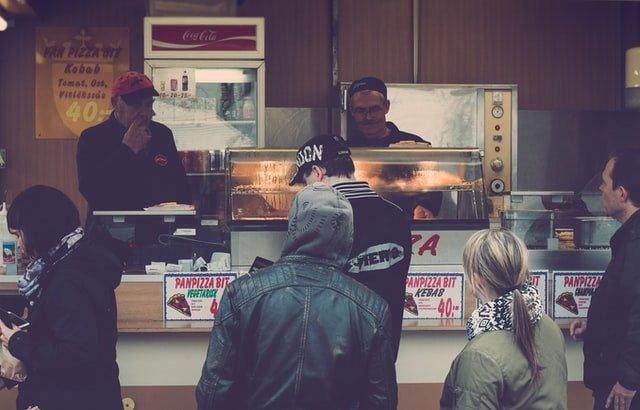 Fast food restaurant selling food to customer